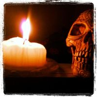 skull and candle by cubisticnebular