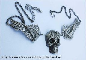 Winged skull necklace by Pinkabsinthe