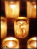Candles at Notre Dame by kiwineen