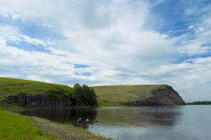 Cliff above the river and the beautiful sky by Korolevatumana