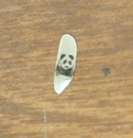 Panda on Grain of Rice by jen4eternity