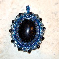 Blue glass pendant by dragonariaes
