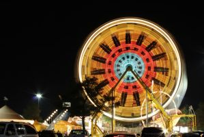 Ferris Wheel at night by GreggFikes
