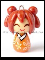 orange kokeshi by MissJin