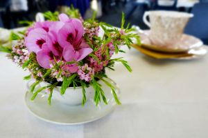 Flowers in a teacup by Aroha-Photography