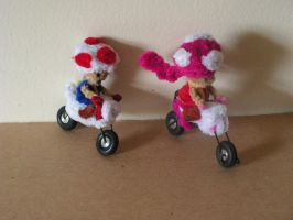 Toad and Toadette on bikes by fuzzyfigureguy