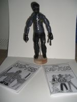BAD ASS ACTION FIGURE with comics by ztenzila