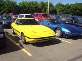 Yellow 1rst gen Mazda RX7 by Mister-Lou