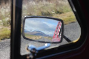 Mountains in mirror are larger than they appear. by Nammi-namm