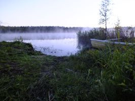 Misty lake and boat by dani221