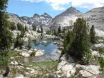 lake in mountains by Scott-A-T-art