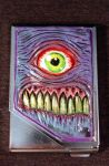Cyclops Freak Cigarette Case by Undead-Art