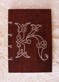 Notebook with celtic knot by NinelivescatArt