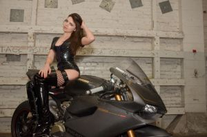Rebel in Latex on a Ducati 1199 racing bike by Studio5Graphics