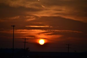 Sinking Red Sun by Gr8-Gatensby