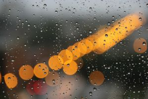Rain drops on my apt window by Rana-Rocks