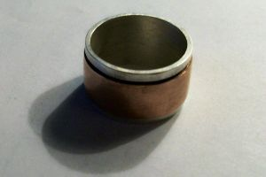 copper n silver spinning ring by Haeddre