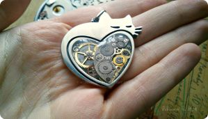 Heart-shaped steampunk cat pendant by IkushIkush