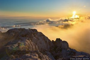 Sunset above the clouds by ivancoric
