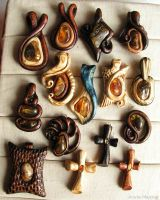 Wooden pendants with Baltic amber by AmberSculpture