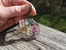 Wire and resin butterflies pendant by whippetgirl