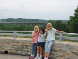 my two sisters and I on A bridge at our home by iker11