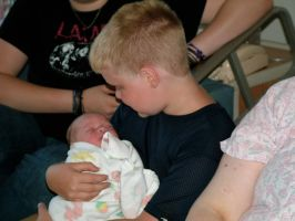 Me Holding Baby Brother At Birth. by PassionateMasochist