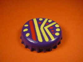 Purple, yellow and red badge. by elniniodelaschapas