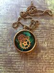 Green pendant with gears by sillysarasue