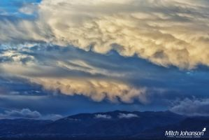 Puffy Clouds Over Salt Lake by mjohanson