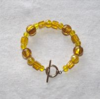 Yellow bead bracelet by MeticulousBlue