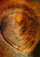 Skeleton in mound by MLeighS