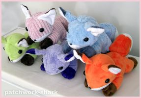 Huggable Foxes by Patchwork-Shark