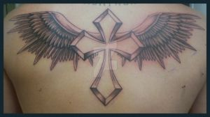 Cross with wings tattoo by hellcatmolly