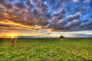 Sunset at Mt Saint Michel by Ganjalvi