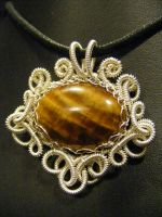 fancy coil wrapped tigers eye by BacktoEarthCreations