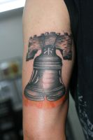 Liberty Bell Tricep by Lucky-Cat-Tattoo