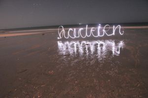 light painting on the plage by kooohla