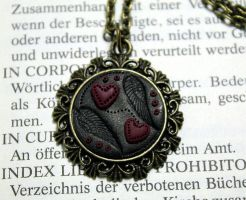 Necklace winged hearts by Sakiyo-chan