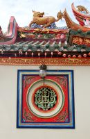 Chinese temple window and roof by Rivendell-PhotoStock