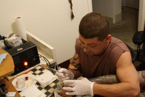 JC tattooing by KarmicCircle