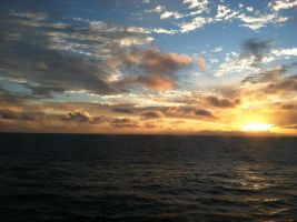 Out at sea sunset by Wintaria