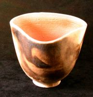 Pit-fired triangular cup by Frost-indri
