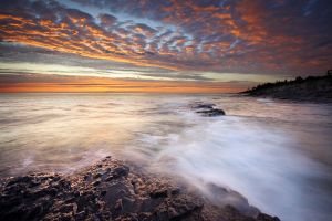 Orange Sky over Lake Superior by tfavretto