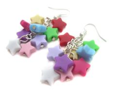 Plastic rainbow star earrings by fairy-cakes