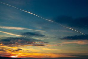 sunset and a plane trail by Pepe09