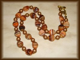 Brown and orange necklace by jasmin7