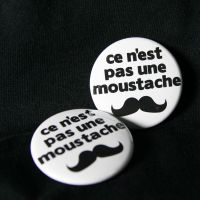 this is not a mustache button by superorangestudio