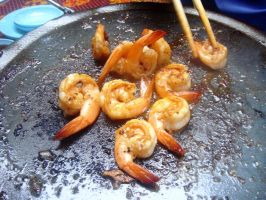 pan grilling shrimps outdoors by plainordinary1