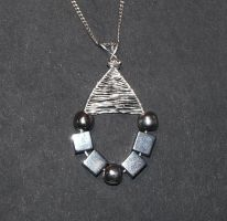Hematite wire wrapped pendant by Amelia-art